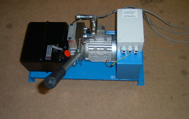 Electro-hydraulic power pack in a drip tray with a quick release self sealing coupling and manual hand pump. Fitted remotely from scissor lifting platform