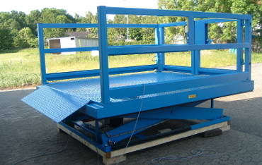 Loading bay scissor lift table with inset bridge plate and heavy duty outward opening bi-parting gates