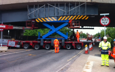 Power lift scissor lifts being used to strengthen road and rail bridges over highways