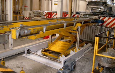 Push chain scissor lift for heavy duty operation in automotive industry. Avoids use of hydraulic fluids